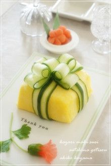 Sushi rice in paper-thin omelette: with cucumber ribbon