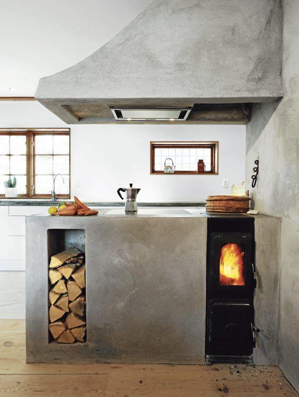concrete hood, firewood box, and custom counters around wood-burning stove