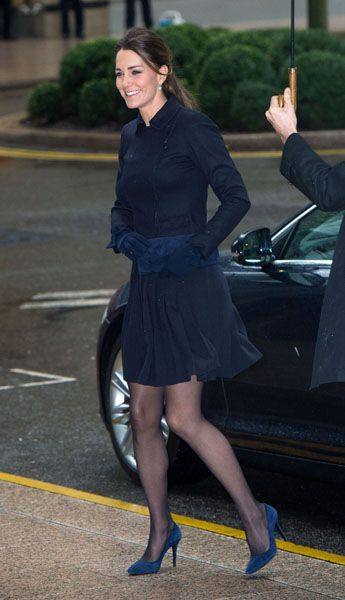 Kate in dark navy blue dress and matching high heels.