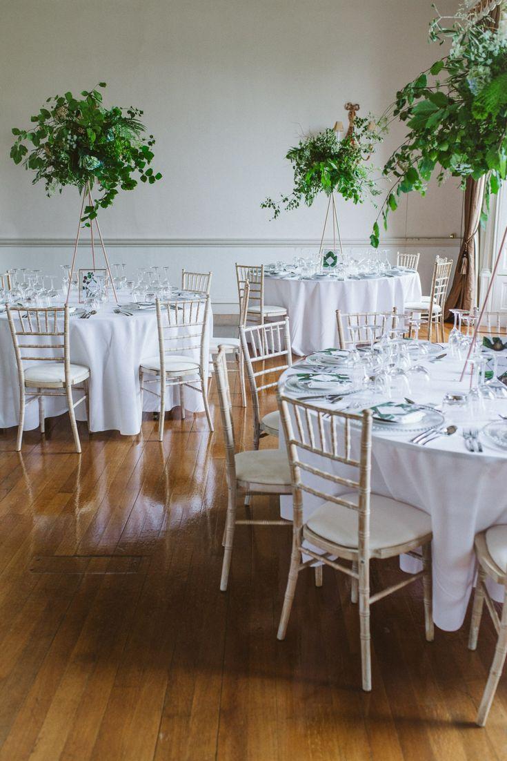 Lush green high set wedding table centerpieces at Fasque Castle estate in Scotland.