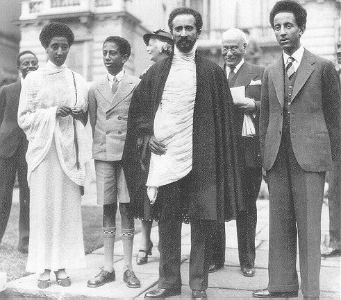 HaileSelassie I and family Foreground, left to right, Princess Tsehai, Prince Mekonnen Duke of Harrar, His Imperial Majesty the Emperor, Crown Prince AsfaWossen, in London during their exile. Behind the Emperor's left shoulder is Dr. Workineh Eshete (A.K.A. Charles Martin) Ethiopian Minister to the Court of St. James.