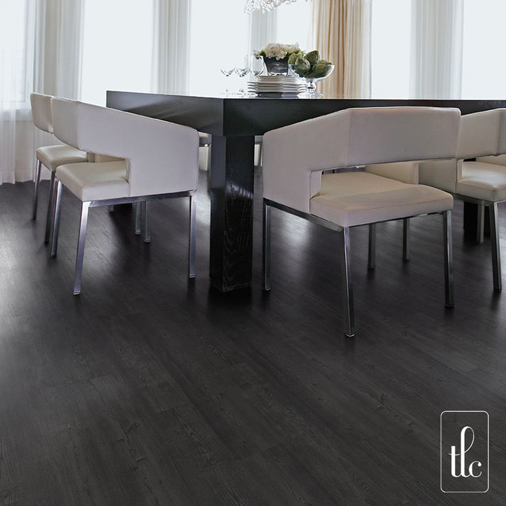 Black Ash - 5272 -   The delicate wood grain pattern of classic ash planks give a simple yet clean, sophisticated finish when installed in any colour. By combining this pattern with black and subtle grey tones. Black Ash evokes a stunning and atmospheric feel. Typical commercial areas that experience heavy foot fall can now be transformed into glamorous and intimate settings.