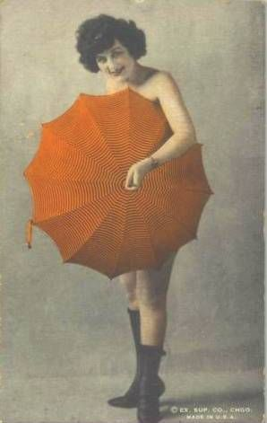 CHICAGO EXHIBIT SUPPLY COMPANY - ARCADE CARD - PIN-UP - WOMAN STANDING BEHIND UMBRELLA - 1920s