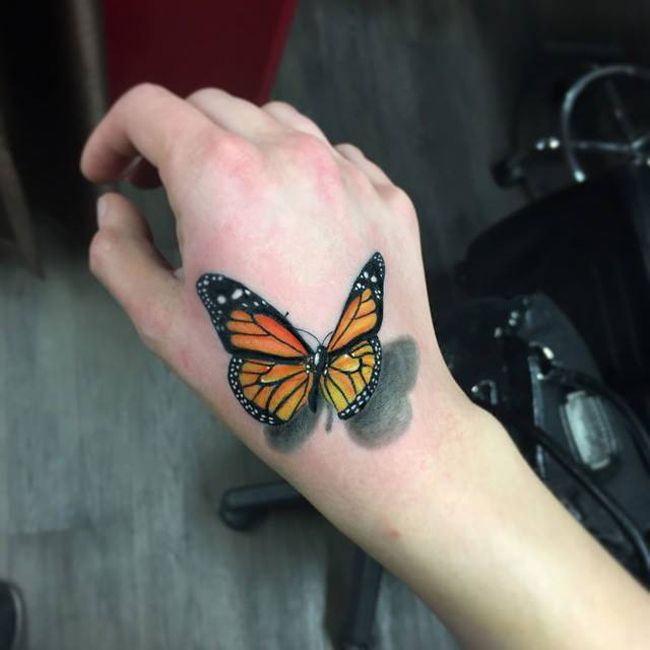 Butterfly hand tattoo by Martin at Chronic Ink Tattoo Shop Toronto ...