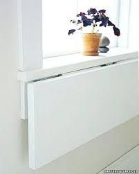 Image result for wall mounted flip down laundry folding table