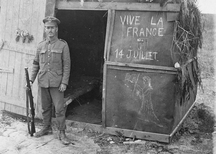 South African sentry at crossroads in front of a hut decorated in honour of the French Bastille Day. Vaux area, 14 July 1916.