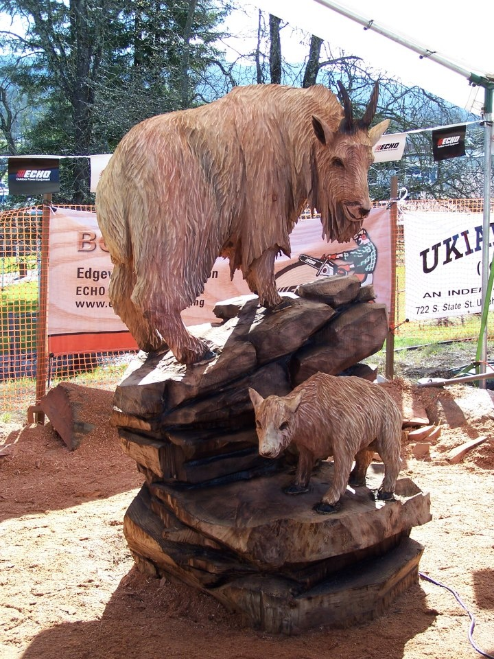 Mountain goats carved by echo chainsaw carving team member