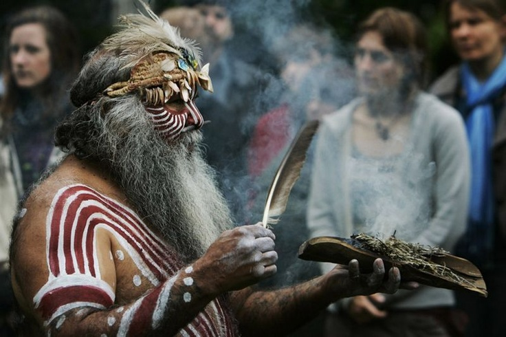 Aboriginal Ngarrindjeri elder Major Sumner from south Australia, in traditional costume, performs a ritual during a ceremony to mark the return of Australian indigenous people's remains back to their homeland.