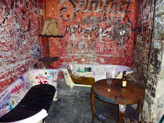 Ruin bar, Budapest - Szimpla Kert Graffiti. Rough décor that shines in a way! popuprepublic.com