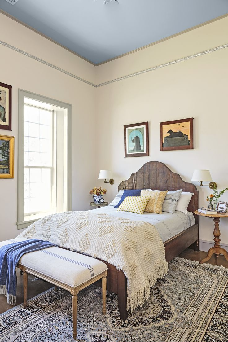 """Homeowners refinished crown and picture molding with a silvery """"rub and buff wax"""" after recovering it from underneath a dropped ceiling they tore out in the master bedroom."""