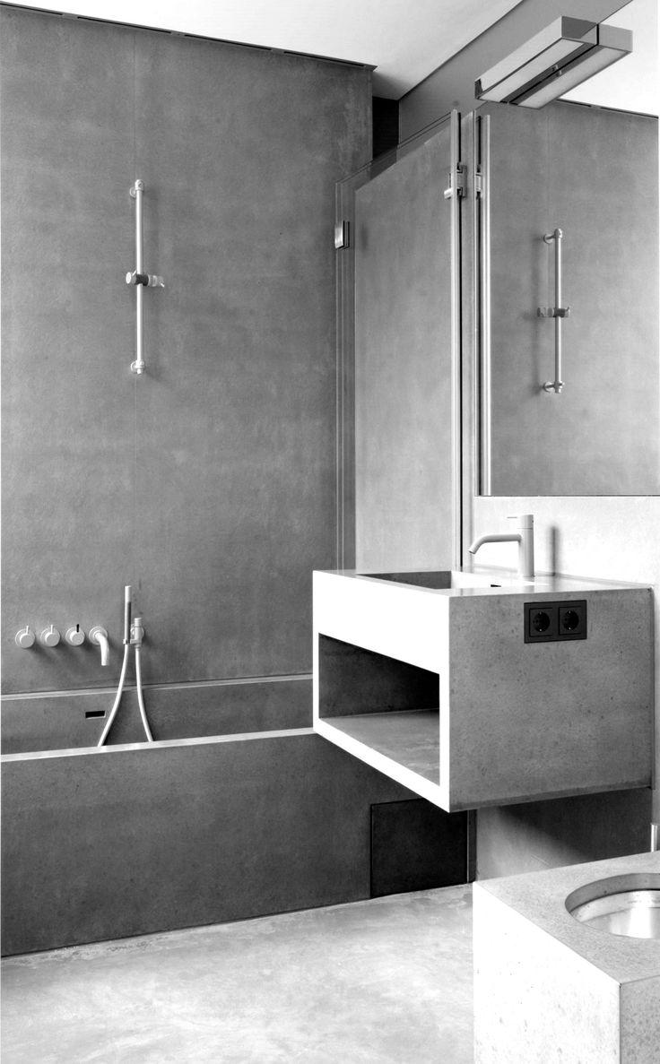 Betonlook, zelfs het badmeubel. strakke lijnen en strakke kranen. Betonlook voor de designliefhebbers.