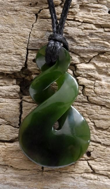 This carved jade or what Maori call Pounamu/Greenstone. The double twist symbolizes the joining together of two people or two cultures for eternity.