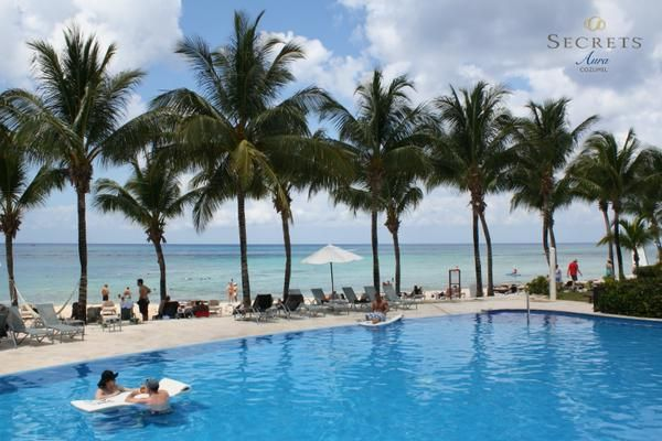 What do you think of the palm-tree lined pool at Secrets Aura Cozumel? If you could see yourself relaxing here for a while, book your tropical vacation today!