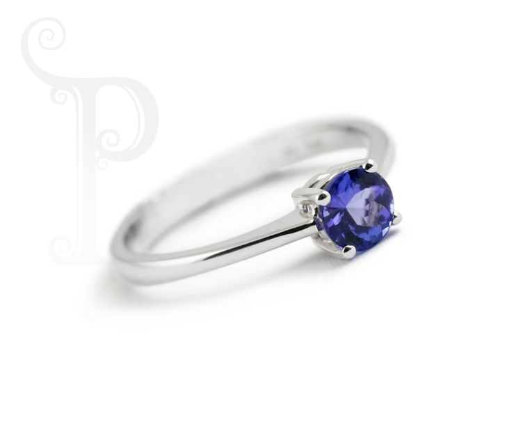 Custom Made 18ct White Gold Solitaire Ring, Claw Set With a Single Round Cut Tanzanite