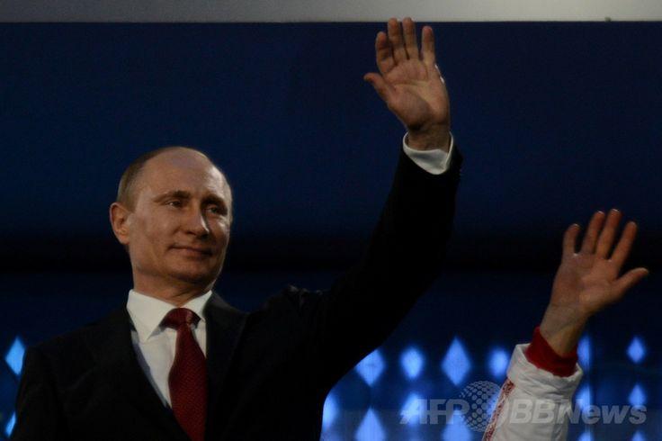 フィシュト五輪スタジアム(Fisht Olympic Stadium)で行われたソチ冬季パラリンピック閉会式に出席するロシアのウラジーミル・プーチン(Vladimir Putin)大統領(2014年3月16日撮影)。(c)AFP/KIRILL KUDRYAVTSEV ▼17Mar2014AFP|ソチ冬季パラリンピックが閉幕 http://www.afpbb.com/articles/-/3010425 #Sochi2014 #Paralympic
