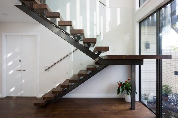 Steel feature stair in Auckland with glass balustrades