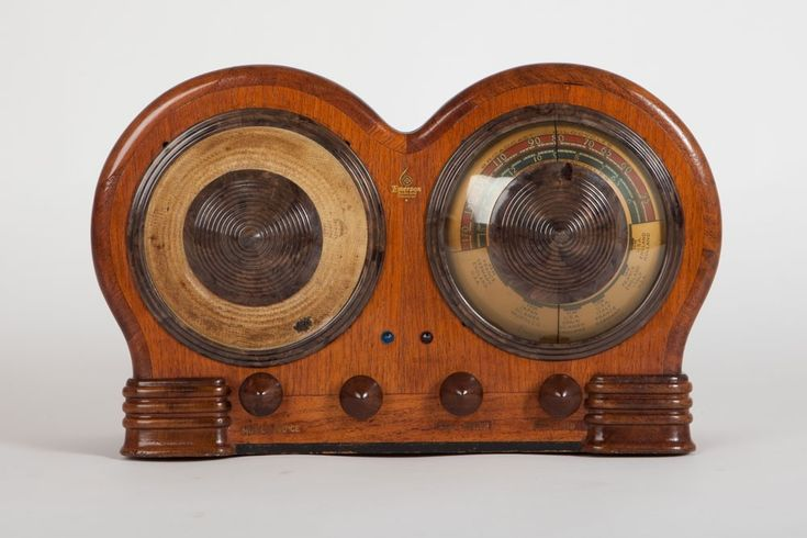"""This Art Deco Emerson """"Mae West"""" radio was designed by Count Alexis De Sakhnoffsky. This provocative design using circular shaped wood was radical in a time when rectangular tombstone radios and furniture-like consoles were stylish. No other radio made by Emerson compares to the Mae West in design. This is what makes the BD-197 quite rare today and would be the highlight of any radio collection. Radio's cabinet was made for Emerson Radio by Ingraham of Bristol, Connecticut"""
