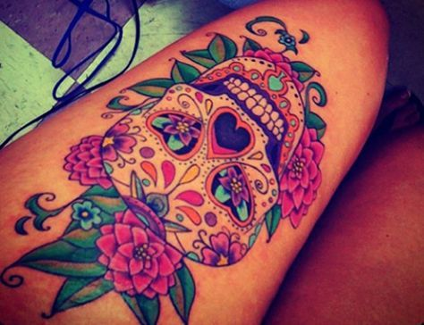 Beautiful sugar skull thigh tattoo
