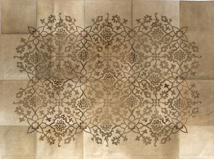 This remarkable,beguiling rug guarantees to completely transform your interior . With a whimsical asian-inspired curved flora motif, it's no wonder its a forever favourite among Art Hide's customers. This timeless beauty will bring you a lifetime of enchantment. The Zirah is created from premium Argentinian cowhide leather, cut and joined together with commercial grade nylon thread.Tile sizes vary according to size of design.It has a ribbon edge finish.Art Hide is always sourced as a…