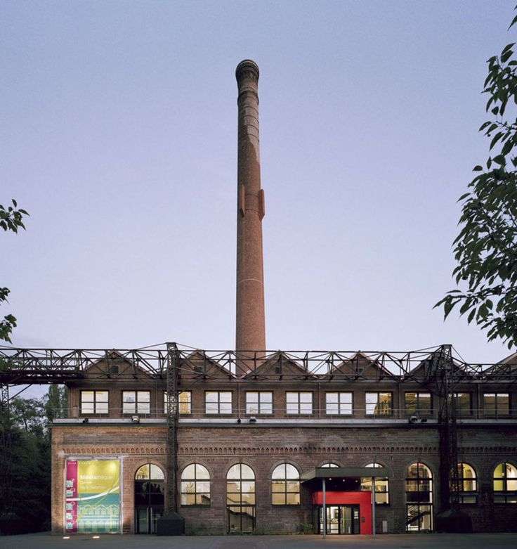 An idea for a fun, magical factory with a zig-zag roof and a tall chimney.
