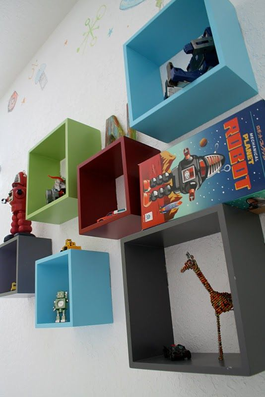 Love the different colored cube shelving.  Cute for the kids' room or the living room if they were black, white, and maybe an accent color.