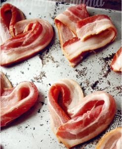 Heart shaped bacon baked in the oven. Would be sweet for Valentine's Day or an anniversary breakfast or brunch.