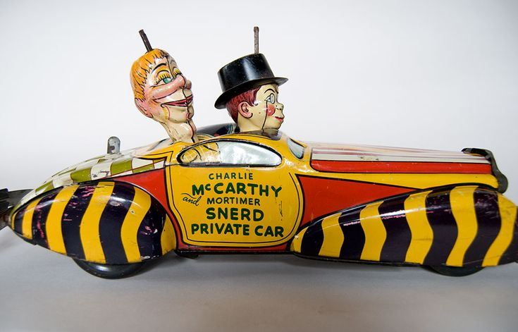 "...our special guests of the circus ""Charlie McCarthy and Mortimer Snerd"" have arrived! (antique toy car)."