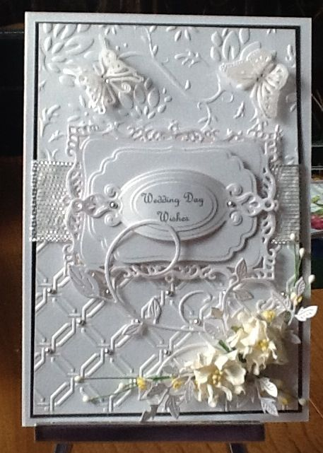 Wedding card with the spellbinders embossing folder and decorative labels 15. Flowers from wild orchid.