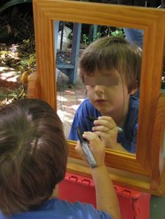 A mirror and a dry erase marker for a self-portrait. This photo would make a fantastic cover for their portrait book.