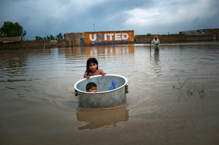 Child floating during floods in Pakistan