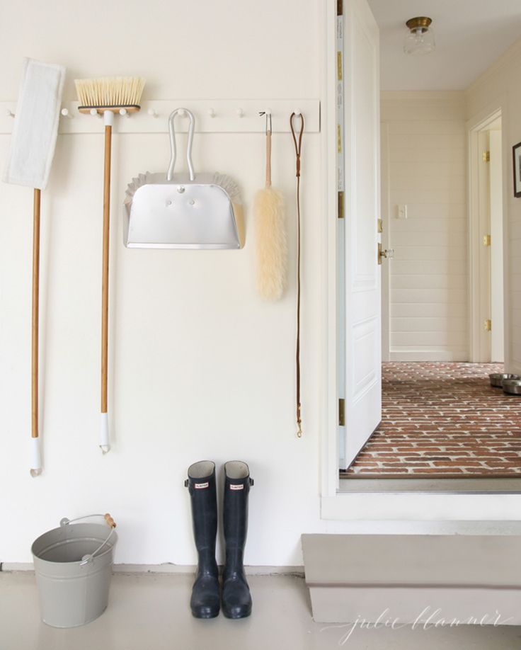 Make a minimalist peg board for your garage or mudroom to store brooms, mops, dustpans and more.