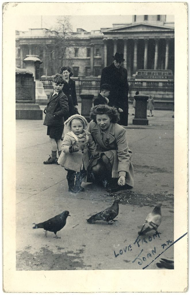 Joan MacLachlan feeding the pigeons in Trafalgar Square, London, 1947.