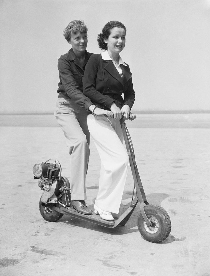 1935 -- This electric scooter attracted the attention of Amelia Earhart Putnam, famous aviatrix, and her pupil, June Travis