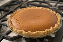 Easy and delicious traditional pumpkin pie recipe with fresh or canned pumpkin puree, cream, brown and white sugar, eggs, and pumpkin spice. ~ SimplyRecipes.com