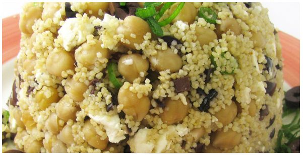 Couscous Feta Salad - Trader Joe's Recipe:   1 cup Whole Wheat Couscous, 1 cup Vegetable Broth, 1 can Garbanzo Beans, 1/2 cup Green Onion (chopped), 1/2 cup Mediterranean Feta Cheese, 1/2 cup Kalamata Olives (diced), TJ's Goddess Dressing (to taste)  **Cook the Couscous in vegetable broth according to directions on package. Fluff with a fork, then add beans, onions, cheese and olives. Dress the mixture and toss lightly... delicious. Enjoy!**