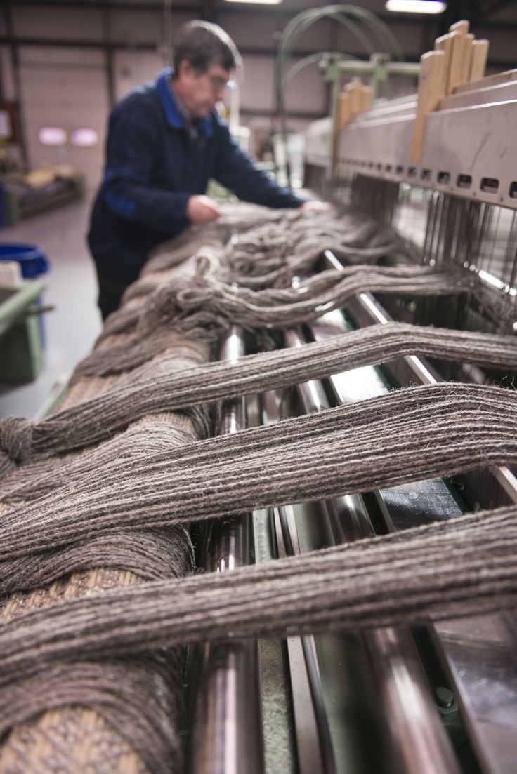 John setting up the dobby loom with undyed wool warp at