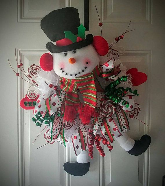 Deco mesh wreath with red and green accent ribbons. Includes white battery operated LED lights