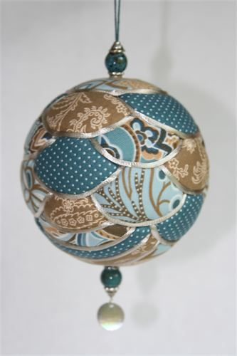 """Kimekomi Ornaments : Kimekomi means """"to tuck"""" in Japanese.  Kimekomi ornaments are made by tucking small pieces of fabric into a foam ball.  The seams are then covered with satin cord.  Here at Stonecroft Crafts, no two Kimekomi Ornaments are the same.  Each one is designed and made individually, making each ornament a one-of-a-kind keepsake.  Kimekomi balls make wonderful gifts that can be beautifully displayed all year long."""