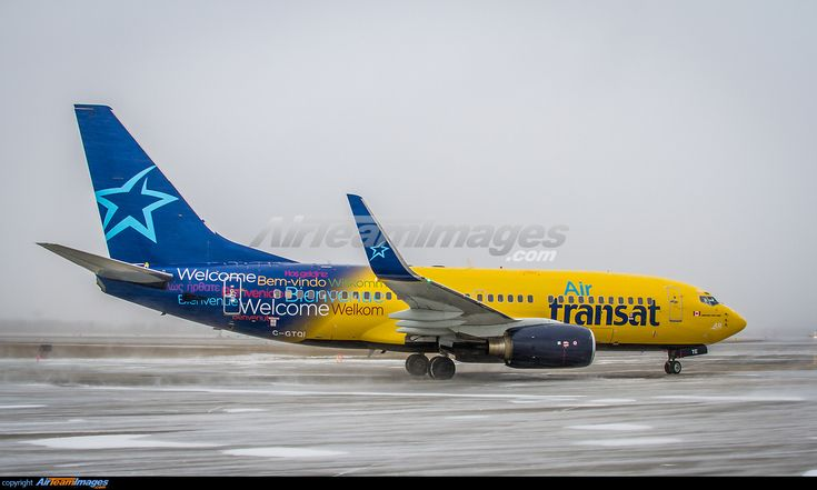 Hybrid livery for this B737 as it leaves snowy Montreal for warmer climate. One of two B737-700 leased by Air Transat from Europe Airpost.