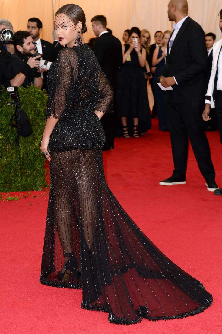 Bringing to mind her 2012 purple, feathered gown (also by Givenchy haute couture), Beyoncé showed up in another stunning, cheek-flashing sheer dress. With a dipping neckline in front and a veil around her face, Bey's look was definitely a Carmen: A Hip Hopera moment, but upgraded.