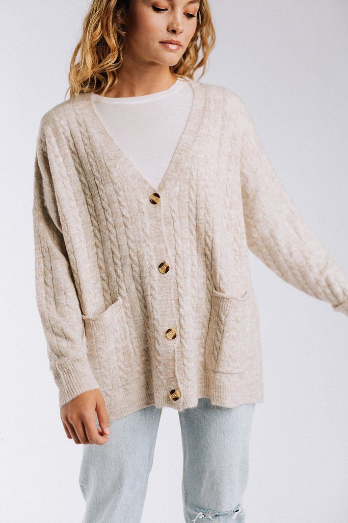 efad0d631 Details  Cable knit sweater Button front V-neckline Oversized fit 70 ...
