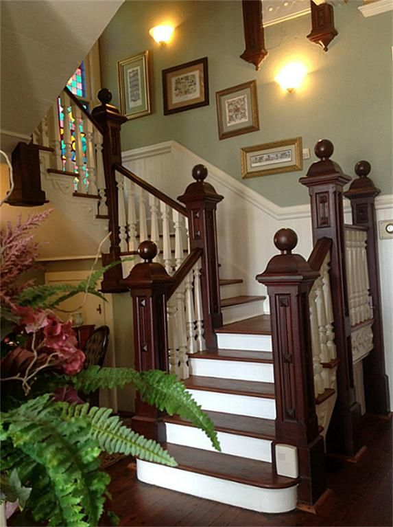 Historic home in Galveston, TX-Love the natural wood/painted staircase!!