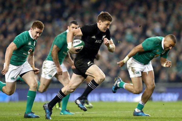 Beauden Barrett Photos Photos - Beauden Barrett of the All Blacks breaks away during the international rugby match between Ireland and the New Zealand All Blacks at Aviva Stadium on November 19, 2016 in Dublin, Ireland. - Ireland v New Zealand - International Match