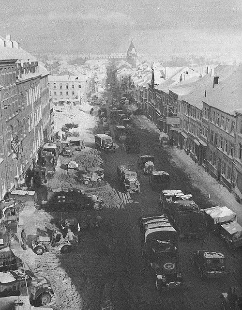 The city of Bastogne under siege by the Luftwaffe during the Battle of the Bulge: Battle Of The Bulge, Small Town, Wwii, Easily, Bands Of Brother, Bastogn Ww2, War Ii, Supplies Moving, Photo