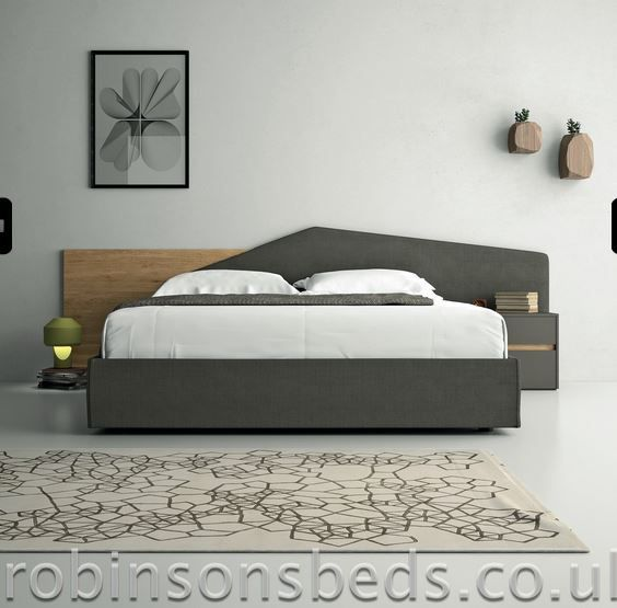 A concept bed in grey and light walnut with storage option.
