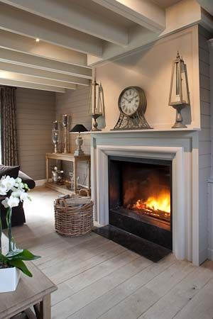beautiful neutral colours in this living room; love the basket and the fireplace!