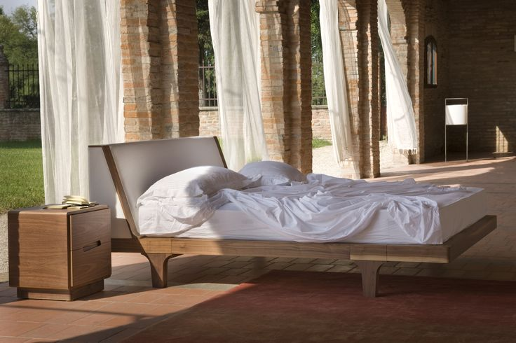MALIBU', made of canaletto walnut wood with upholstered headboard.