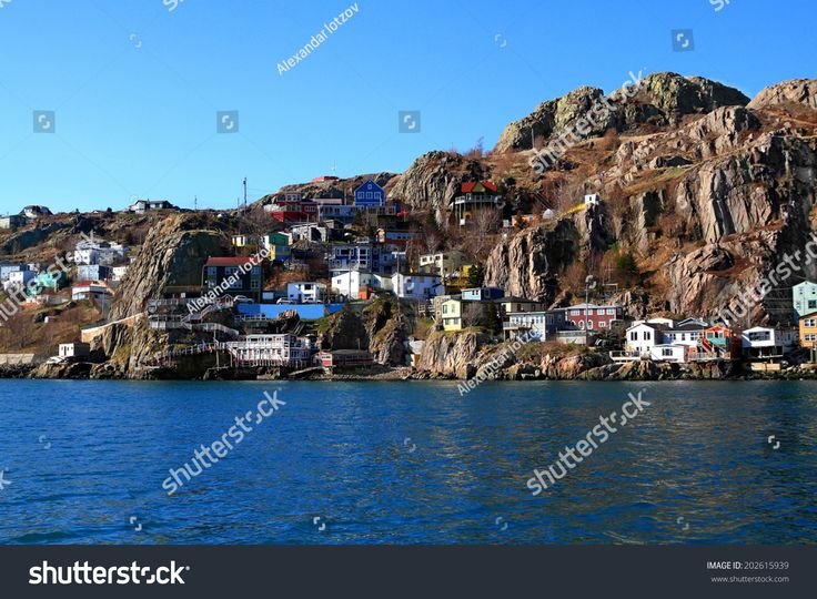 From the Atlantic Ocean level View over Newfoundland Capital St.Johns Houses on East end which are reaching the foot steps of million years old rock of Signal Hill