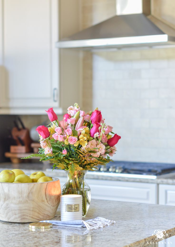 Kitchen island flowers with basket of apples