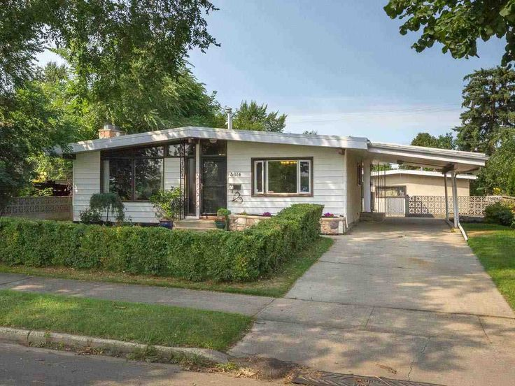 Mid-Century modern at the east end of Ada Boulevard! With over 2400 sq ft of total living space &...